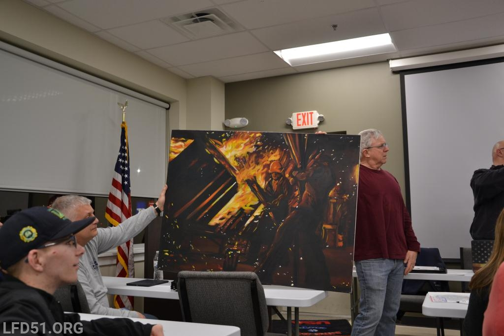LFD Chief, Ken Shuler looks on at the presentation.